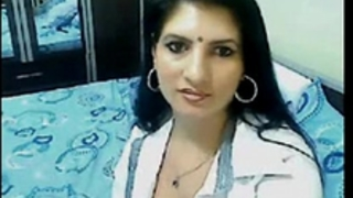 Hot & sexually excited high class bhabhi home alone chatting on web camera