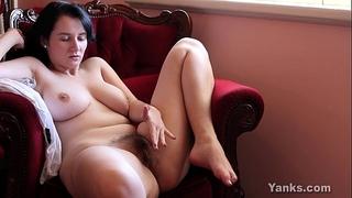 Busty dark brown aeryn masturbating her unshaved slit